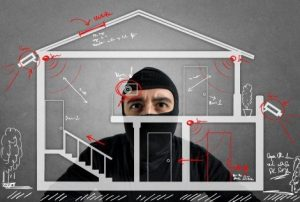 Intruder preparing for break-in of your home