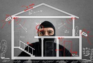 Intruder preparing for break-in of your home